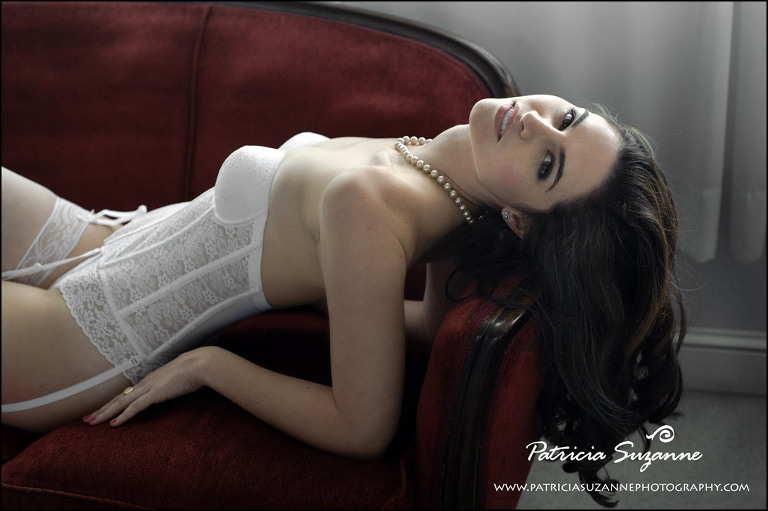woman in white lace lingerie on antique red sofa