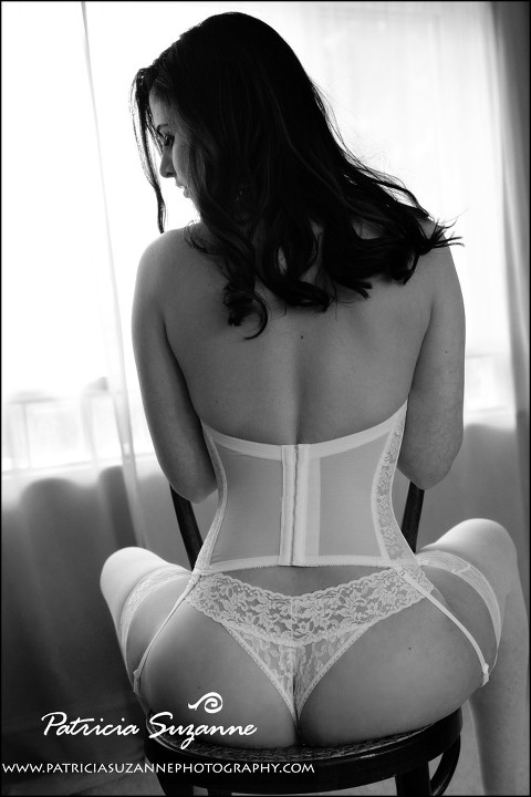 photo of woman from behind straddling a chair showing derriere